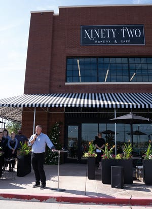 Kerry Ritchie, Betenbough Companies executive director and board member, addresses the crowd at the ribbon cutting for Lubbock's newest bakery, Ninety-Two Bakery & Cafe, on Wednesday.