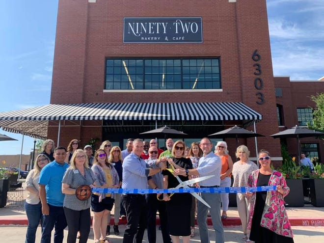 Ninety-Two Bakery & Cafe, 6303 82nd St. Holding scissors are Executive and Board of Directors Kerry Ritchie and Walter Cunningham; CEO Rick Betenbough and Director of Hospitality Marcie Truby. Holding ribbon  are Chamber Ambassadors Traci Cheek, left, and Shannon Younger. Others pictured are staff, family, friends and additional Lubbock Chamber Ambassadors.