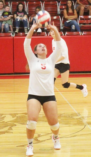 Crowley County High School's Loganne Mason sets up a kill attempt in the Chargers' three-set win over Swink Tuesday in Ordway.