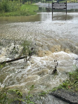 Mill Creek raged over its banks Wednesday afternoon, putting the entrance to the Mill Creek Country Club along U.S. Route 50 underwater. Small creeks and culverts jumped their banks all over Mineral County as Tropical Storm Ida passed through the area.