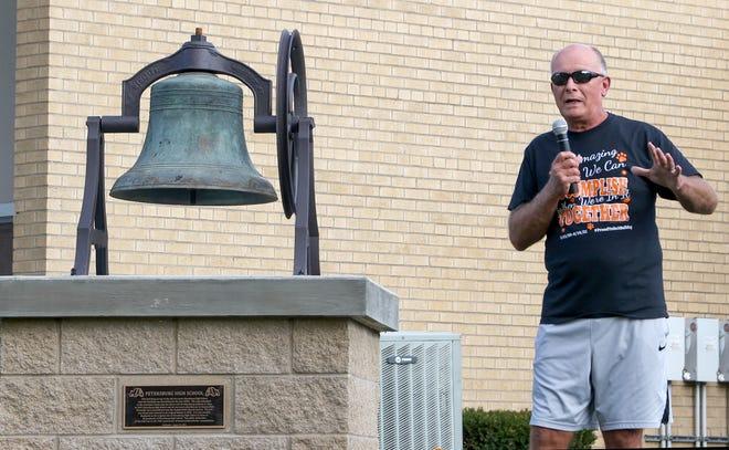 Summerfield Schools former superintendent Jack Hewitt speaks about the Petersburg High School restored 1869 Meneely bell at the dedication outside the Summerfield Elementary School this week.