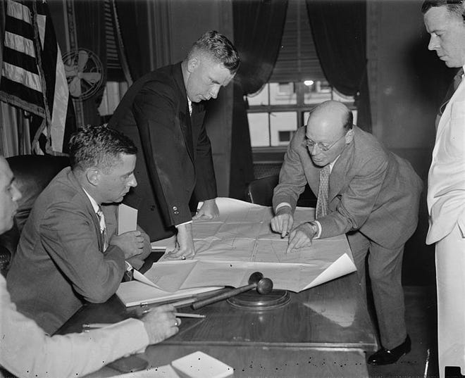 """This was a meeting of legal advisors in the """"Republic Steel"""" unfair labor practices case in Washington, D.C., in July, 1937. From left to right: Unidentified man; Edwin S. Smith, member, National Labor Relations Board; Stanley Switter, Chief of Police, Massillon, Ohio; Luther Day, attorney for Republic Steel; unidentified man. The National Labor Relations Board charged Republic Steel with violations of the National Labor Relations Act after the """"Little Steel strike"""" of spring 1937. During the strike, several people died at the Massillon works."""