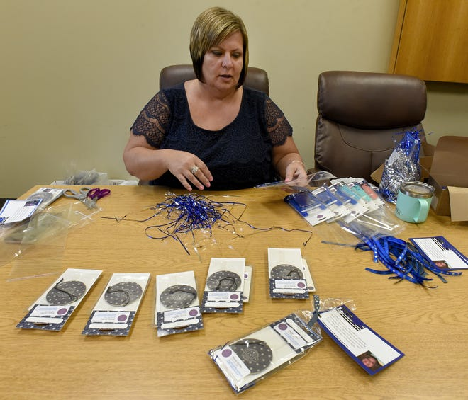 Shelly Griffin with Scentsy putting together 200 scent bags for the police to place in their vehicles in Monroe County