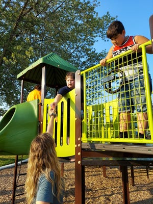 Children play on the playground during the End of Summer Bash.