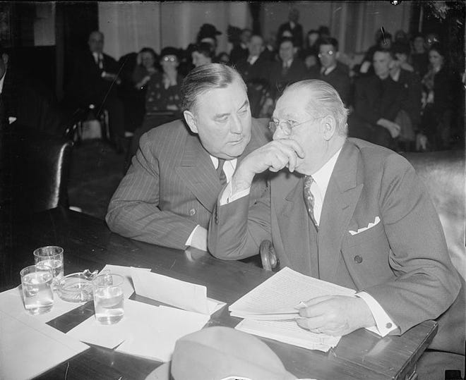 """This photo shows Mayor Daniel J. Shields (left) of Johnstown, Pennsylvania, talking with his attorney, Samuel A. King, during hearings held by the Subcommittee Investigating Violations of Free Speech and the Rights of Labor, Committee on Education and Labor, U.S. Senate, in Washington, D.C., in March, 1938. Mayor Shields told the committee he had destroyed records concerning the payment of approximately 500 """"special officers"""" sworn in during the Little Steel strike of spring and summer 1937."""