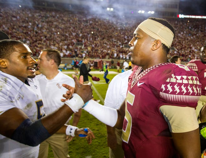 Florida State quarterback Jameis Winston, right, greets Notre Dame quarterback Everett Golson after Florida State won 31-27 in an NCAA college football game in Tallahassee, Fla., Saturday, Oct. 18, 2014.