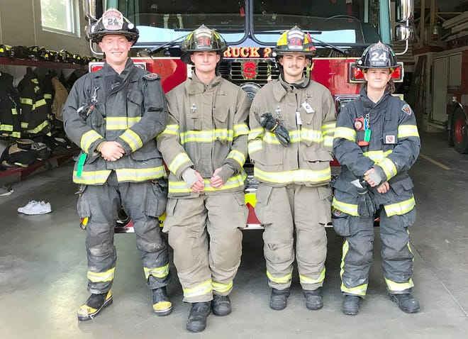 SUNY Morrisville students, from left, Daniel Sparkowski, Jorden Wendt, Justin Wendt and Willie Burns pose Aug. 31 in front of new aerial truck 247 at the Morrisville Fire Department. They are part of a Mutual Aid Program welcoming college students to the department that also includes Emmalee Howard and Eric Wieland.