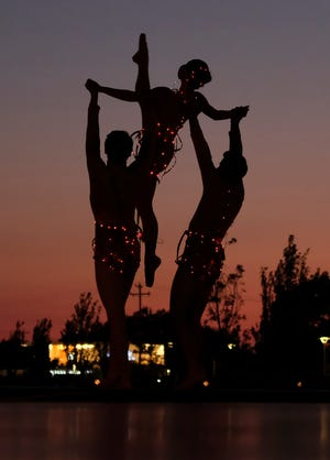 """Dancers perform at Oklahoma City Ballet's inaugural """"Ballet Under the Stars"""" at Scissortail Park on the Love's Travel Stops Stage Friday, October 9, 2020."""