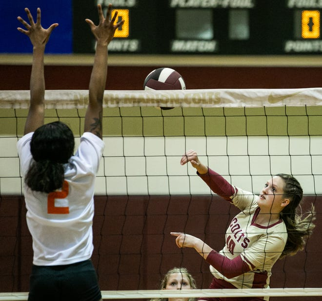 North Marion's Kinley Manning spikes one over the net against Eastside on Tuesday night in Citra. North Marion won 25-12, 25-18 and 25-11.