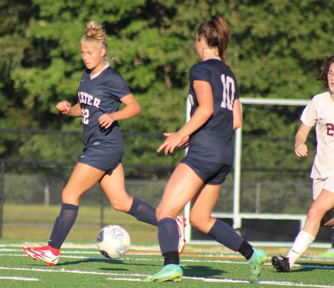 Exeter's Elizabeth Boys (22) and Maggie Hall (10) move the ball down the field during last week's win over Hanover.