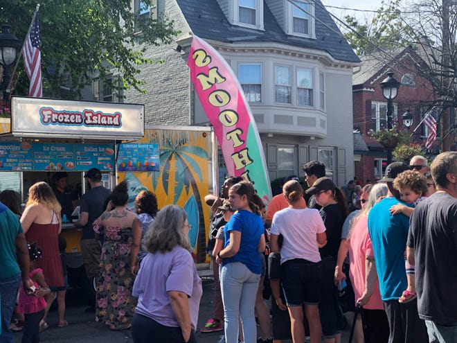 Frozen Island dessert stand caters to a full line at StroudFest 2019. The vendor will return for this year's StroudFest on Saturday.