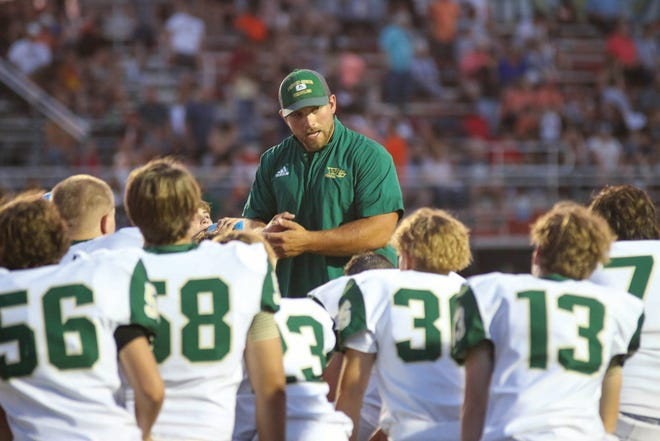 Woodward-Granger assistant coach Brent Carlson talks to the team during a game against Madrid on Friday, Aug. 27 in Madrid.