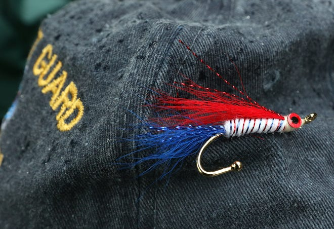 Retired Coast Guard Capt. Ron Marafioti ties fishing flies and gives them as gifts to veterans.