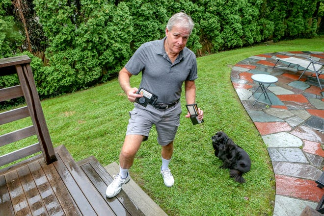 Mark Patinkin, with his collared shirt tucked into his cargo shorts, high white crew socks and New Balance shoes, showing that only in one realm — his wallet having been replaced by a cellphone — has he updated his mojo.