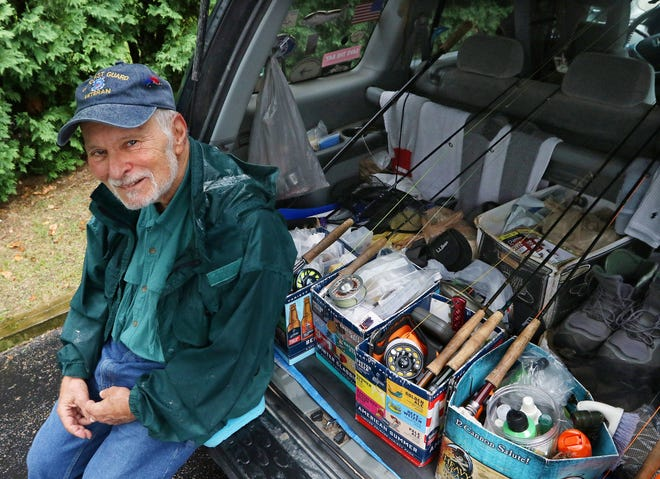 Retired Coast Guard Capt. Ron Marafioti, an avid fisherman, was helped by two veterans after he had a flat tire on Route 95. He had to move his fishing gear to get to the spare tire and the Army vets did the rest.