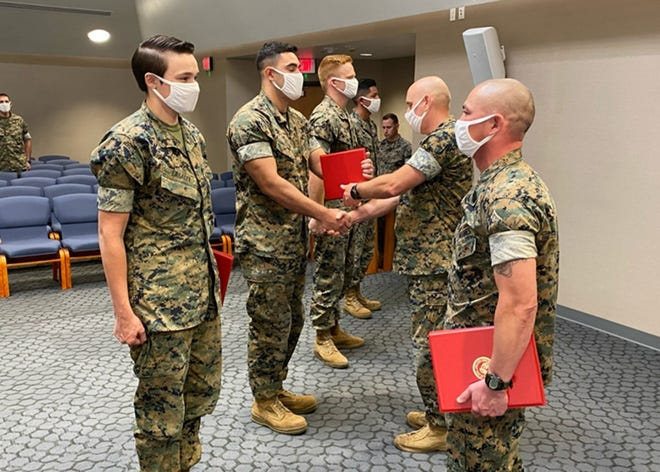 During a ceremony Aug. 26 at Specker Chapel, Col. Charles Long, Fort Leonard Wood Marine Corps Detachment commander, recognized key players in the unit's recent Commanding General's Readiness Inspection, held Aug. 17 to 19 here . (Courtesy photo)