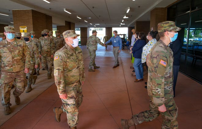 Soldiers with the Oregon National Guard arrive to aid healthcare workers at McKenzie Willamette Hospital in Springfield.