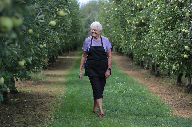 Rose Kuner, owner of Kuner's Fruit Farm in Green, walks through her golden delicious orchard at the farm along Arlington Road. Kuner's pick-your-own season runs the last two weeks of September and the first week of October.