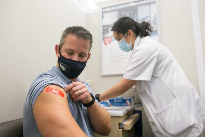 Pharmacy manager Jessica Fernandez administers a flu shot to U.S. Rep. Adam Kinzinger on Wednesday, Sept. 1, 2021, at Walgreens, 1145 N. Alpine Rd., in Rockford.