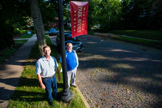 Lou Sabo, left, and Cole Hay pose for a portrait on Park Avenue in South Bend.