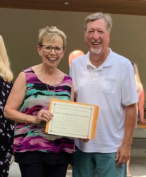 The Spencer Presbyterian Church and manse building were awarded a certificate as a National Historic Landmark in a ceremony in the DNR pavilion at the Indiana State Fair on Aug.12.  Pastor David Lee and elder Sylvia Dyar accepted on behalf of the congregation of the 151 year old church on Main Street in Spencer.