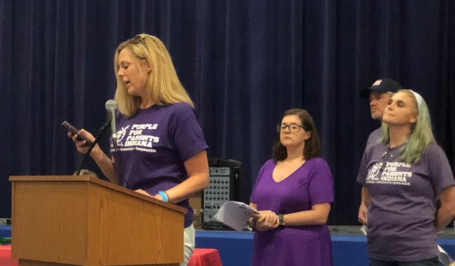 Jennifer McWilliams, the CEO and founder of Purple for Parents Indiana, addresses the Spencer-Owen school board. She traveled from north of Indianapolis to attend the meeting. Also shown are Megan Elmore and Sommer Tolley as they wait to address the school board.