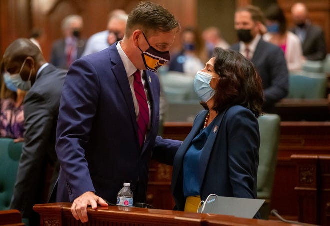 Illinois State Rep. Tim Butler, R-Springfield, talks with Illinois State Rep. Lisa Hernandez, D-Cicero, after passage of the Illinois legislative maps proposal on the floor of the Illinois House of Representatives at the Illinois State Capitol in Springfield, Ill., Tuesday, August 31, 2021. [Justin L. Fowler/The State Journal-Register]