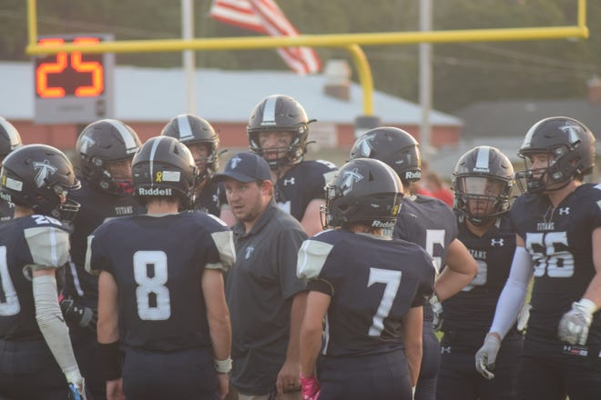 Annawan-Wethersfield Coach Tony Gripp talks to his Titans during a time out in Friday's game against Monmouth United.