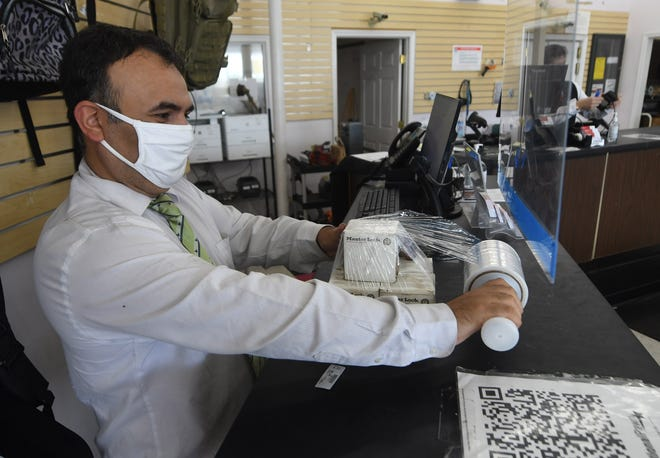 Pawnbroker Douglas Zelaya wraps up some locks at National Pawn in Wilmington, N.C., Wednesday, September 1, 2021. The shop at 1702 Dawson St. opened in April after it had previously been Picasso Pawn.     MATT BORN/STARNEWS