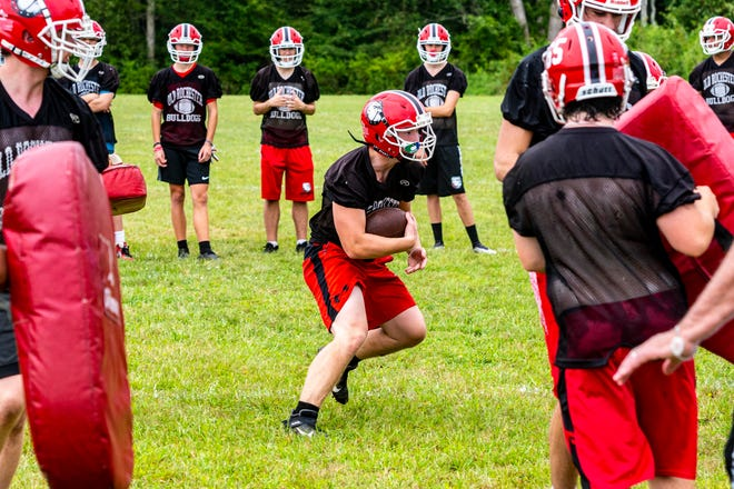 Old Rochester's Walter Rocha sprints to the hole during preseason training.