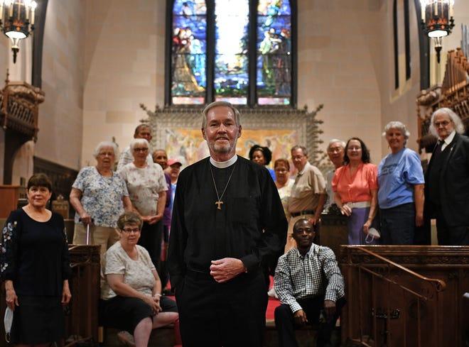 Father John McGinty among parishioners at St. Matthew's Episcopal Church, 695 Southbridge St.