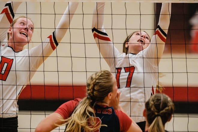 Tusky Valley's Taylor West, left, and Ashley Merrick, right make a block at the net against Indian Valley Tuesday.