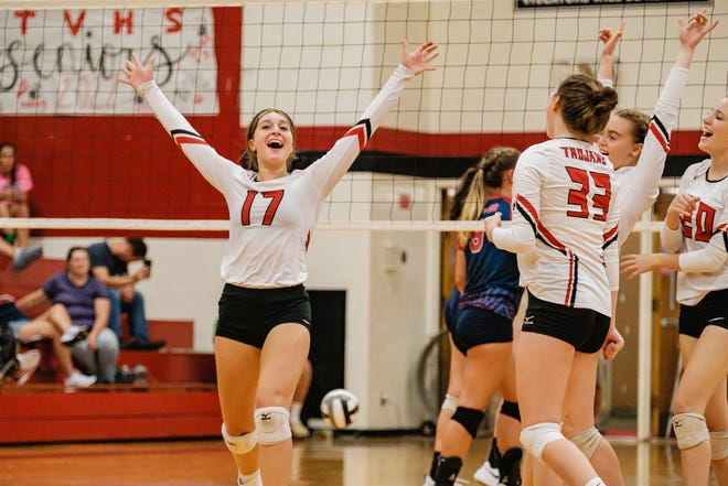 Tusky Valley's Ashley Merrick celebrates her game-winning kill against Indian Valley Tuesday night.