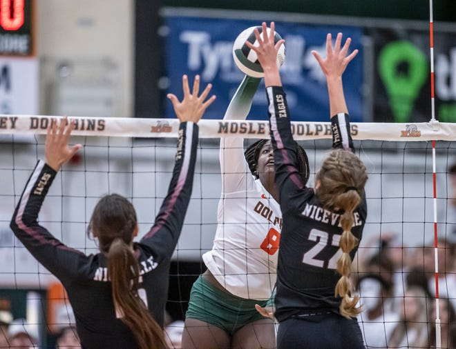 Mosley junior Alysia Fingall goes up for a spike against Niceville. The Dolphins hosted Niceville in a volleyball match Tuesday, August 31, 2021.