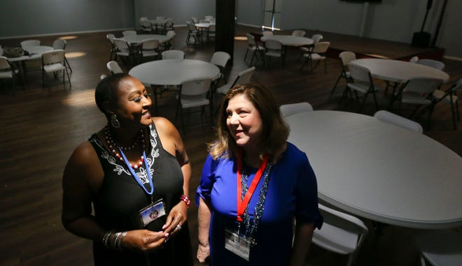 The Alabama Blues Project is partnered with Shindig to provide a series of free concerts. BJ Reed, from the Alabama Blues Project, talks with Shindig event coordinator Jane Wright in the venue regrading the Saturday concert. [Staff Photo/Gary Cosby Jr.]