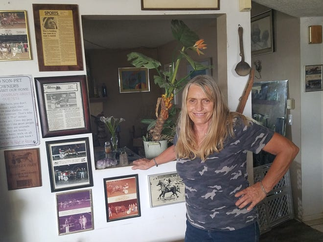 The walls of Gabriele Bernat's Apple Valley home are covered with photos and memorabilia marking her career as the first winning female sulky driver in California.