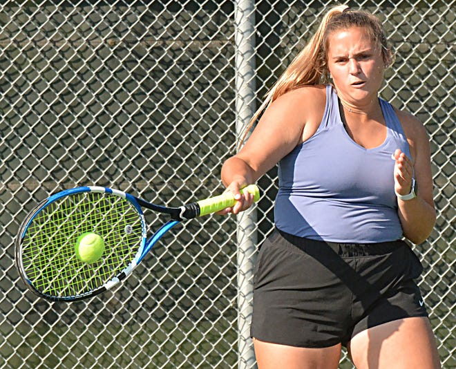 Watertown's Grace Ortmeier connects with the ball during a high school girls tennis dual against Sioux Falls Lincoln on Tuesday at Highland Park. The Arrows defeated the five-time defending state champions 5-4.