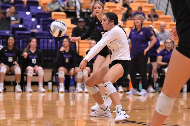Wylie's Dusti Grant (3) returns a serve during Tuesday's match against Midland Christian. Grant had a team-high 13 digs in the 25-15, 25-13, 25-18 sweep.