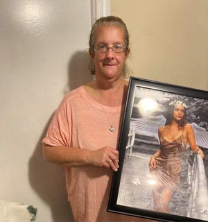 Karen Uyar holds a photo of her daughter Yasemin who was killed in July. Yasemin's ex-boyfriend has been charged with her murder.