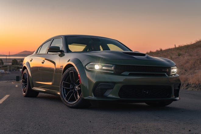 The 2021 Dodge Charger Scat Pack Widebody is powered by the 392-cubic-inch HEMI® V-8 engine.
