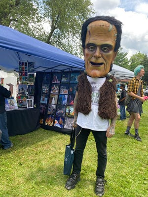 An attendee is decked out in Frankenstein gear for FrankenFest on July 10, 2021, in Lansing.