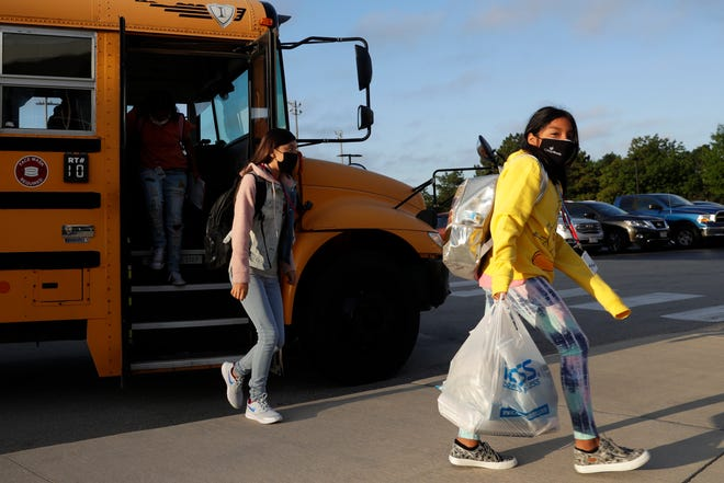 Sixth-grade students arrive at Edison Middle School on the first day of school on Sept. 1 in Green Bay.