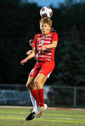Fishers High School's Ethan Slabaugh (13) heads the ball during the first half of the game against Noblesville High School on Aug. 31, 2021 at Fishers High School.