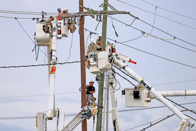 Linesman work on power lines on Paris Road in Chalmette as they attempt to restore power following Hurricane Ida. Photographed on Tuesday, August 31, 2021.