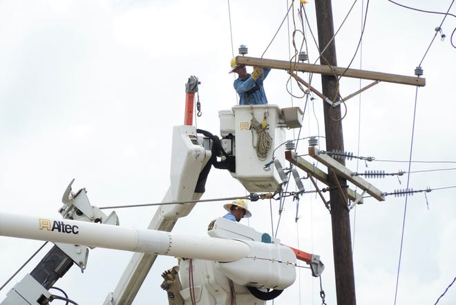 Linemen for Wilson Energy, of North Carolina, repair power lines in Houma on Wednesday, Sep. 1, 2021, after Hurricane Ida left nearly all of the area's residents without electricity.