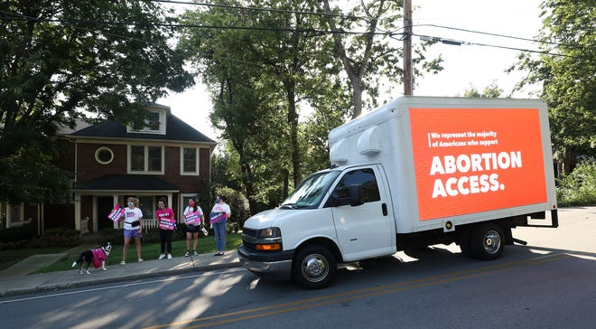 Planned Parenthood demonstrators protest the recent attempts to restrict abortion outside the home of Sen. Mitch McConnell in Louisville, Ky. on Sep. 1 2021.