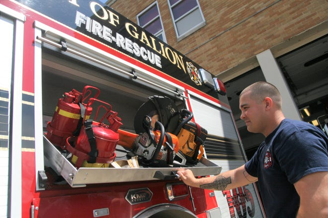 Aaron Barnhart, a firefighter and paramedic for Galion, inspects the chainsaws in one of the department's fire engines on Wednesday.