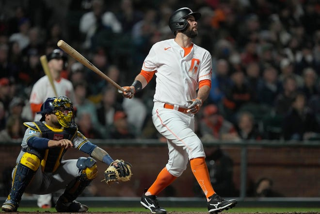 San Francisco Giants' Brandon Belt hits a solo home run against the Milwaukee Brewers during the sixth inning Tuesday night in San Francisco. The Giants were sporting their City Connect jersey, something the Brewers will get in the future.