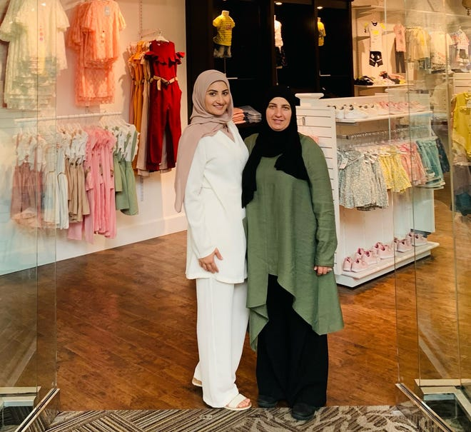 Dalal Dahabra (left), a nurse, and her mother, Maysoun Ahmad, a former longtime day care provider, recently opened EverKid, a new children's clothing store at Southridge Mall.
