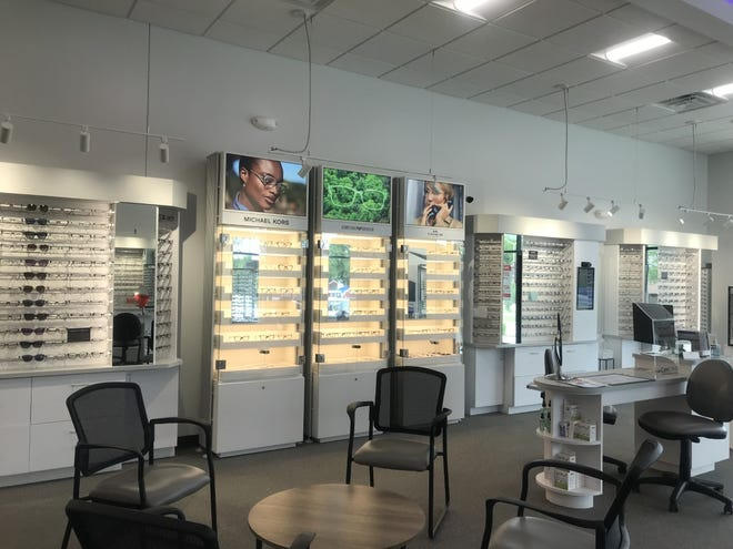 """Wisconsin Vision's new, expanded locations, including this one in Waukesha, feature """"brand walls"""" showcasing their products."""